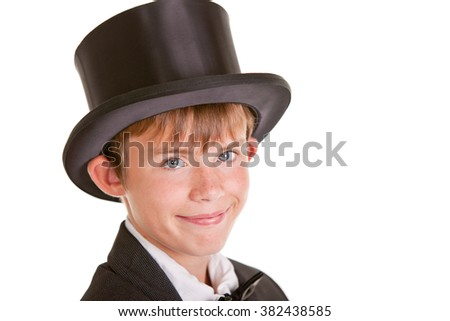 Close up Young Boy Wearing Formal Attire with Top Hat, Looking at the Camera with Happy Face Against White Background. - stock photo