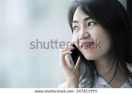 Close up young business woman speaking mobile phone. - stock photo