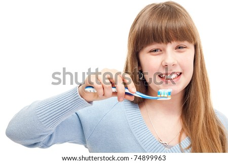 close up, young girl brushing her teeth happily, isolated on white