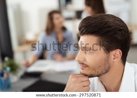 Close up Young Handsome Businessman with Hand on his Chin Sitting at the Table with Pensive Facial Expression, Looking into Distance. - stock photo
