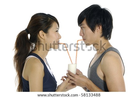 close up young love couple drinking milk. - stock photo