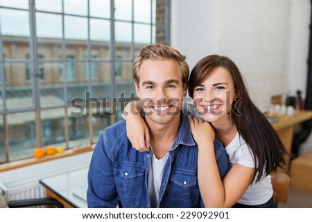 Close up Young Smiling Boyfriend and Girlfriend Inside the House Looking at Camera - stock photo