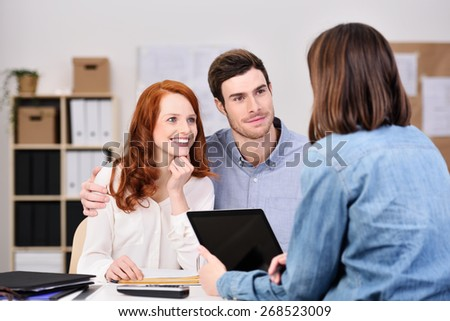 Close up Young White Couple Listening to a Businesswoman Talking About Business Plans with Tablet Computer - stock photo