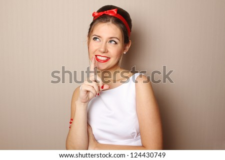 Close-up young woman in the style of 60s. White dress, red lips - stock photo