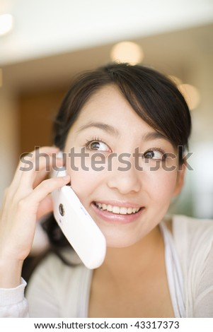 Close-up young woman talking with phone