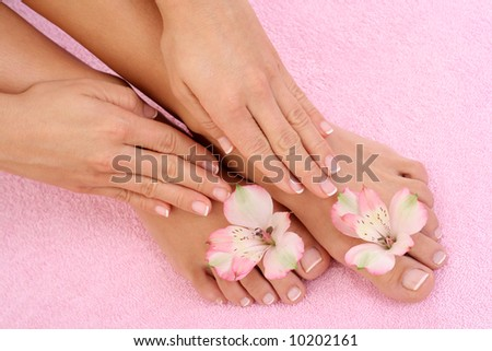 close-ups of beautiful female legs and hands - beauty treatment - stock photo