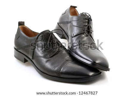 close-ups of black shoes isolated on white