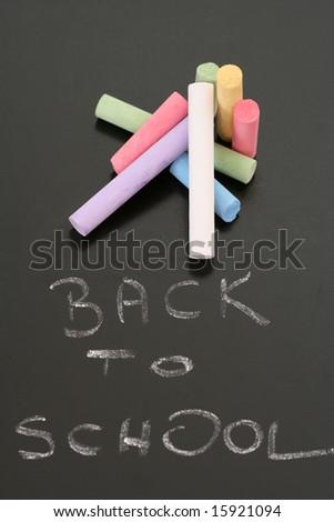 close-ups of blackboard and colorful chalks