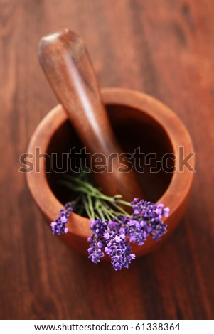 close-ups of lavender with mortar and pestle - beauty treatment - stock photo