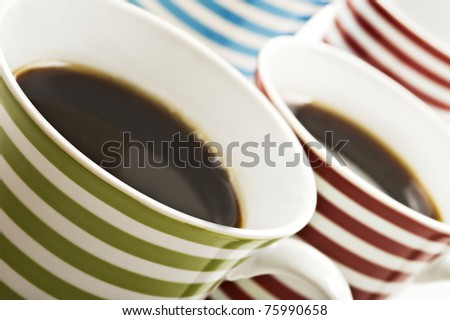 Close ups of mugs of black coffee - stock photo