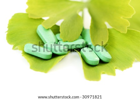 close-ups of pills and ginko leaves - alternative medicine