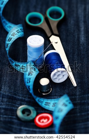 close-ups of sewing stuff on blue