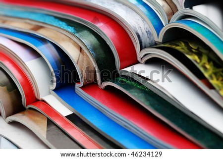 close-ups of stack of colorful magazines - publications - stock photo