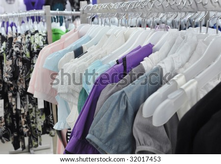 Close-ups of the clothes on the racks - stock photo