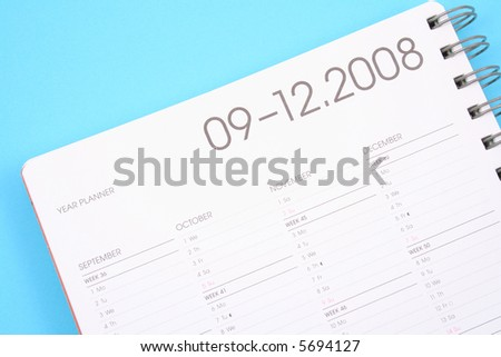 close-ups of year planner on blue background