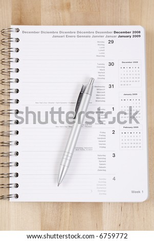 close-ups of year planner on the table - stock photo