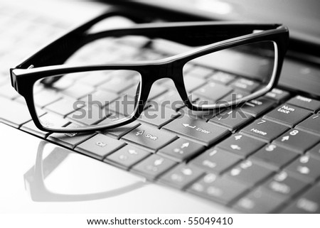 close-ups on glasses on laptop - office life