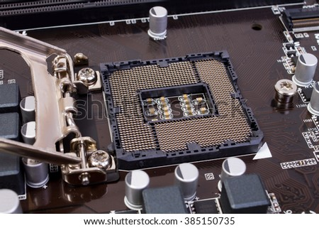 close view at empty processor socket on computer motherboard - stock photo