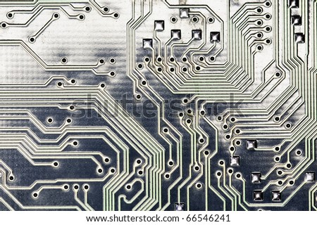close view detail of   computer circuit chips on a golden light. - stock photo
