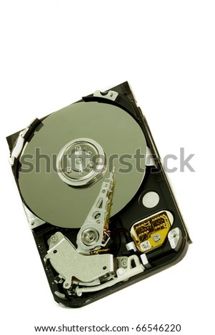 close view detail of the inside of a computer harddisk isolated on a white background.