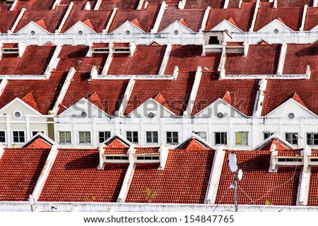 Close View Looking Down on Red White Terraced Houses - Melaka, Malaysia - stock photo