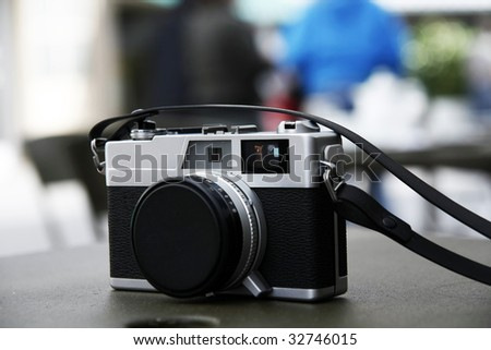Close view of a digital camera on top of a table. - stock photo