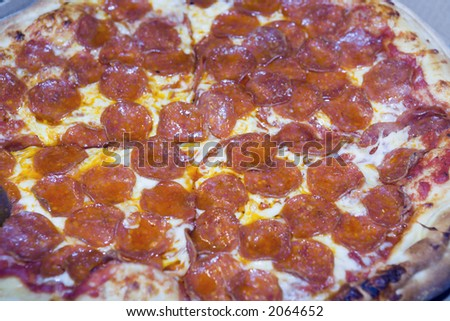 Close view of a fresh pepperoni pizza