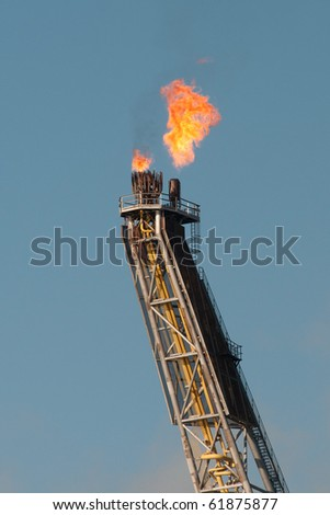 close view of a gas flare of an FPSO offshore oil rig - stock photo