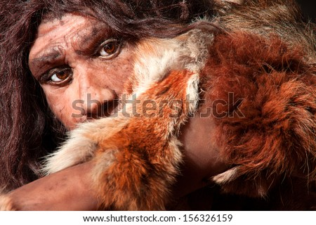 close view of a neanderthal man, focused in eyes expression - stock photo