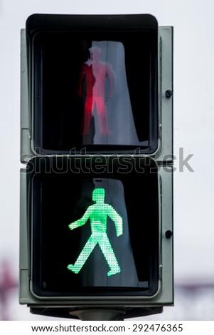 Close view of a pedestrian traffic light. - stock photo