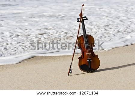 Close view of a violin at the Atlantic seashore - stock photo