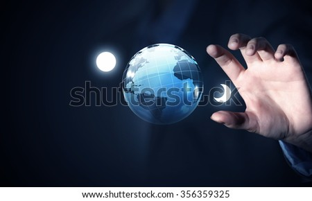 Close view of businessman taking digital Earth planet