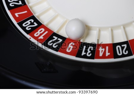 Close view of casino roulette and ball on number nine