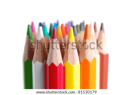 Close view of colored pencils, isolated on a white background