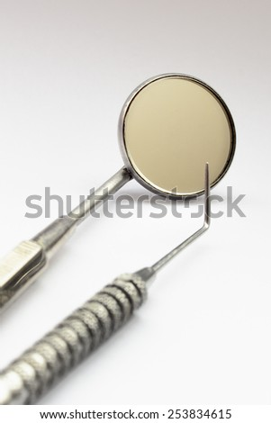 Close view of dentist tools in a white background - stock photo