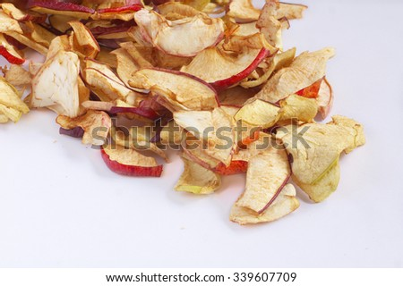 Close view of  dried apples on a white background