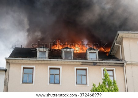 Close view of flames in an upper story window - stock photo