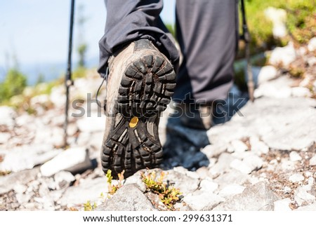 Close view of hiker boots, travel background. - stock photo