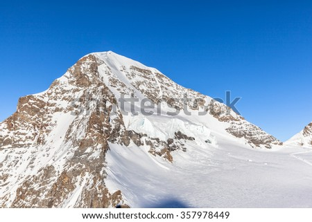 Close view of peak Monch from Jungfraujoch, on the view platform of Sphinx Observatory, on Bernese Oberland, Switzerland.