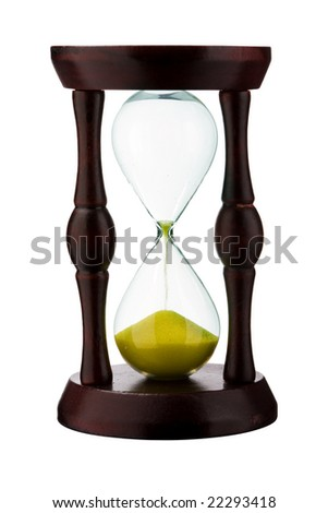 Close view of sand flowing through an hourglass. - stock photo