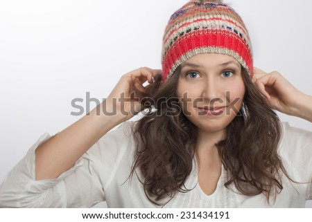 Close view of Smiling girl Holding  Own knitted hat