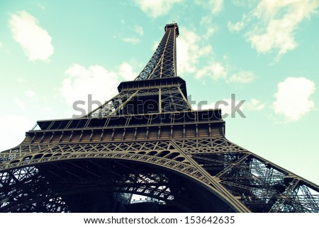Close view of the eiffel tower up to the top at the sky/Retro Eiffel Tower