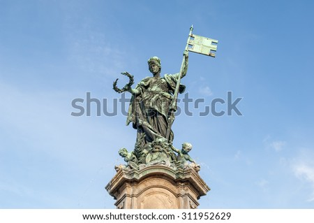 """Close view of the historic sculpture at the spring """"Frankoniabrunnen"""" in Wuerzburg in Bavaria - stock photo"""