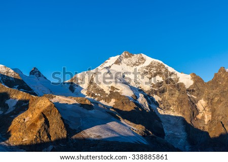 Close view of the swiss alps including Piz Bernina and the glacier from Diavolezza in the morning sunshine. It is the highest mountain in the Eastern Alps and in swiss Canton of Grisons, Switzerland. - stock photo