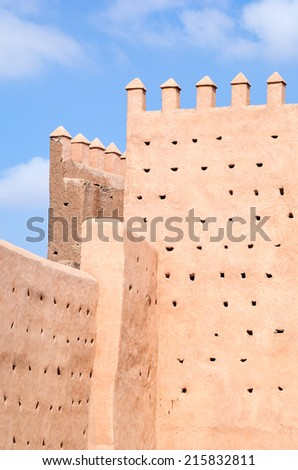 Close view of the typical antique defense walls of Marrakech in Morocco - stock photo