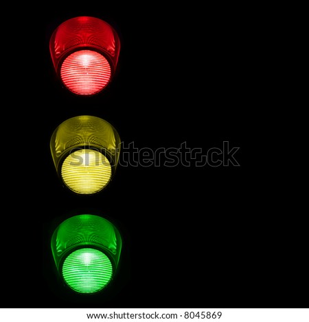 Close view of traffic lights against an available black background for latter use.