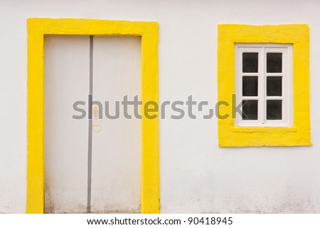 Close view of white and yellow old house - stock photo