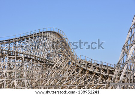 Close view on the construction of a large wooden rollercoaster - stock photo