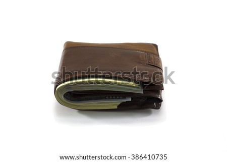 Close wallet with money on white background - stock photo