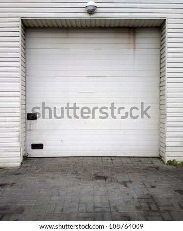 Close white garage doors - stock photo